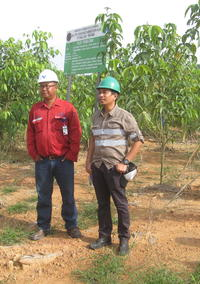 Ishak Yassir and Rehab specialist from in front of experimental site Singlurus