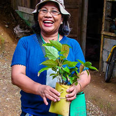 Participant of a Rainforestation training with her recently collected wildings, Philippines