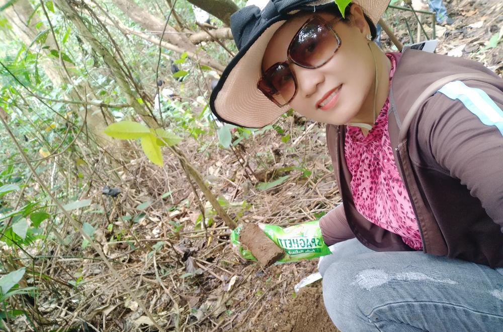 Liza Velasco planting a tree