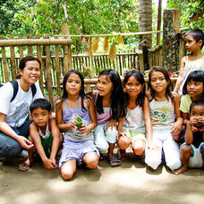 Hazel Consunji of ELTI with children from the local community at a Rainforestation training
